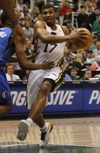 Rick Egan   |  The Salt Lake Tribune  Utah Jazz guard Ronnie Price (17)  takes the ball do the hoop, as Dallas Mavericks guard Rodrigue Beaubois (3) defends, in NBA action Utah vs. Dallas, in Salt Lake City, Saturday, March 26, 2011.