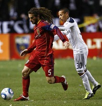 Djamila Grossman  |  The Salt Lake Tribune  Real Salt Lake's Kyle Beckerman (5) defends the ball against Los Angeles Galaxy's Paolo Cardozo (30) during the second half of a game at Rio Tinto Stadium in Sandy, Utah, on Saturday,  March 26, 2011. RSL won the game.