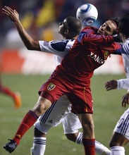 Djamila Grossman  |  The Salt Lake Tribune  Real Salt Lake's Fabian Espindola (7) and Los Angeles Galaxy's Leonardo (22) head the ball during a game at Rio Tinto Stadium in Sandy, Utah, on Saturday,  March 26, 2011.