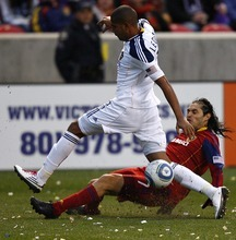 Djamila Grossman  |  The Salt Lake Tribune  Real Salt Lake's Fabian Espindola (7), falls as he tries to kick the ball away from Los Angeles Galaxy's Leonardo (22) during the first half of a game at Rio Tinto Stadium in Sandy, Utah, on Saturday,  March 26, 2011. RSL won the game.