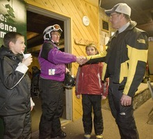 Paul Fraughton  |  The Salt Lake Tribune   As Isaac Noel, 10, left, looks on, Rachael Shutt with her son, Dain, shakes hands with Canyons Superintendent David Doty at a meet-and-greet at Brighton Ski Resort.