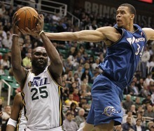 Washington Wizards' JaVale McGee, right, fights for a rebound with Utah Jazz's Al Jefferson during the first half of an NBA basketball game in Salt Lake City, Monday March 28, 2011. (AP Photo/George Frey)
