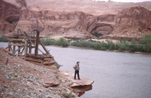 The Olympia Bar and a water wheel from an old mining operation are now under the waters of Lake Powell.  Special Collections, J. Willard Marriott Library, University of Utah