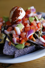 Francisco Kjolseth     The Salt Lake Tribune Vegan nachos are one of the dishes available at Ginger's Garden Cafe in Springville. The mostly a vegan restaurant is located inside Dr. Christopher's Herb Shop.