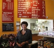 Rick Egan      The Salt Lake Tribune  Owner Amber Radman serves sandwiches at Rosie's Deli, which is  inside the Jade Market on 200 South in Salt Lake City.