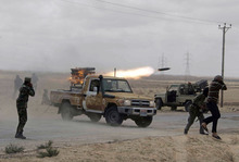 Libyan rebels fire rockets at troops loyal to Libyan leaderMoammar Gadhafi on the road between Ajdabiya and Brega, Libya, Thursday, March 31, 2011. An important Libyan oil town became a no man's land Thursday as rebels to the east traded rocket and mortar fire with Gadhafi's forces to the west. (AP Photo)