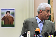 Libya's Foreign Minister Moussa Koussa  reads a statement to foreign journalists at a hotel in  in Tripoli, in this Friday March 18, 2011 file photo.  Libya's foreign minister has left Tunisia for London after a two-day visit shrouded in secrecy, Tunisia's official news agency said Wednesday, March 30 2011. Moussa Koussa traveled on an early afternoon flight on an unidentified Swiss carrier from the Tunisian resort of Djerba toward the British capital, the TAP news agency reported. (AP Photo / Jerome Delay, file)
