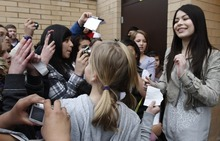 Rick Egan   |  The Salt Lake Tribune   Miranda Cosgrove signs autogrphs at Crescent Elementary School in Sandy, Monday, March 28, 2011. Cosgrove, star of  TV show