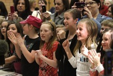 Rick Egan   |  The Salt Lake Tribune  Students and their mothers cheer and take photos of singer/actress Miranda Cosgrove at Crescent Elementary School in Sandy on Wednesday. Cosgrove, star of  TV show