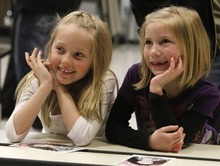 Rick Egan   |  The Salt Lake Tribune  Natalie Degering (left) and Kennady Kasteler, both 8, watch as their school greets singer/actress, Miranda Cosgrove at Crescent Elementary School in Sandy on Wednesday. Cosgrove, star of  TV show