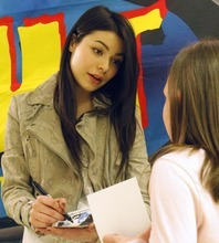 Rick Egan   |  The Salt Lake Tribune  Sadie Utley, 9, gets an autograph from singer/actress, Miranda Cosgrove at Crescent Elementary School in Sandy on Wednesday. Cosgrove, star of  Nickledeon TV show
