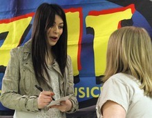 Rick Egan   |  The Salt Lake Tribune  10-year-old Cassidy Kiser gets an autograph from singer/actress, Miranda Cosgrove at Crescent Elementary School in Sandy on Wednesday. Cosgrove, star of  TV show