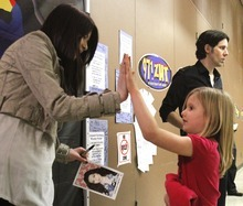 Rick Egan   |  The Salt Lake Tribune  5-year-old Alivia Boe gets a high-five from singer/actress, Miranda Cosgrove at Crescent Elementary School in Sandy on Wednesday. Cosgrove, star of  TV show
