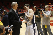 Chris Detrick  |  The Salt Lake Tribune   Jimmer Fredette jokes around with coach Dave Rose after a BYU victory this season.