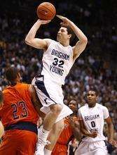 Djamila Grossman  |  The Salt Lake Tribune  Jimmer Fredette hits a 3-pointer, pushing aside UTEP's Gabriel McCulley, in a Dec. 23, 2010 game in Provo.