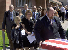 Steve Griffin  |  The Salt Lake Tribune   Shawna Harris, center left, is joined by her daughters Kristina and Kirsten as they follow the casket of her husband, Kane County sheriff's Deputy Brian Harris, as it is delivered to the gym of Valley High School during funeral services  in Orderville on Friday, Sept. 3, 2010.