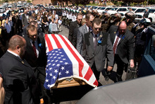 Steve Griffin  |  The Salt Lake Tribune Shawna Harris is joined by daughters Kristina and Kirsten as they follow the casket of her husband, Kane County Sheriff's Deputy Brian Harris, Sept. 3 in Orderville.