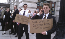Louie Vazquez (Left) and Drew Starr (Right) both of California hold signs at Temple Square in an attempt to get tickets to a session of LDS General Conference in between sessions at noon on Saturday. Cimaron Neugebauer |The Salt Lake Tribune