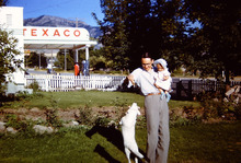 L. Tom Perry, holding his daughter, Barbara Perry, while playing with their dog in 1950 in Hyde Park, Utah. Courtesy of the family.