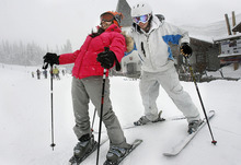 Scott Sommerdorf  |  The Salt Lake Tribune Nepalese refugee Bhakti Dahal loses her balance during her first ski lesson with Westminster student Joey Cathcart at Solitude Resort, Sunday, April 3, 2011. With the help and support of Westminster College and Solitude Ski Resort, 15 to 20 refugee children skied for the first time. The children, who range in age from 8 to 15, come from countries including Bhutan, Burma, Nepal, Burundi, Sudan, Somalia, Ethiopia and the Congo.