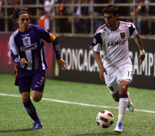 U.S. Real Salt Lake's Javier Morales, right, plays the ball as he is followed by Costa Rica's Deportivo Saprissa's Diego Cordero during a CONCACAF Champions League soccer game in San Jose, Costa Rica, Tuesday April 5, 2011. (AP Photo/Ronald Reyes)