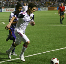 U.S. Real Salt Lake's Will Johnson, front, plays the ball followed by Costa Rica's Deportivo Saprisa Armado Alonso during a CONCACAF Champions League soccer game in San Jose, Costa Rica, Tuesday April 5, 2011. Real Salt Lake won 3-2 on aggregate. (AP Photo/Ronald Reyes)