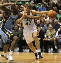 Rick Egan   |  The Salt Lake Tribune  Utah Jazz forward Andrei Kirilenko takes the ball inside, as Memphis Grizzlies forward Sam Young defends, in a game Jan. 1, 2011.