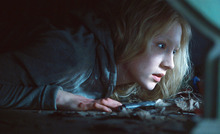 In this film publicity image released by Focus Features, Saoirse Ronan is shown in a scene from