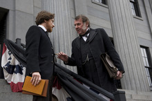 Young lawyer Frederick Aiken (James McAvoy, left) talks to his boss, Sen. Reverty Johnson (Tom Wilkinson), about the case of Mary Surratt, one of those accused in the assassination of Abraham Lincoln, in a scene from