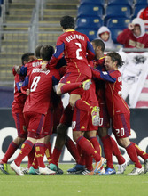 Real Salt Lake players celebrate after a goal by Chris Schuler, hidden, in the first half of an MLS soccer game against the New England Revolution, Saturday, April 9, 2011, in Foxborough, Mass. Real Salt Lake won 2-0. (AP Photo/Michael Dwyer)