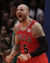 Former Jazz forward Carlos Boozer makes his first appearance in Salt Lake City with his new team, the Chicago Bulls, on Wednesday night.  (AP Photo/Kathy Willens)