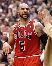 Chicago Bulls' Carlos Boozer celebrates after beating his old team the Utah Jazz during the second half of an NBA basketball game in Salt Lake City, Wednesday, Feb. 9, 2011. The Bulls beat the Jazz 91-86. (AP Photo/George Frey)
