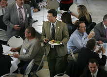 Rep. Dean Sanpei, R-Provo, looks for a seat at a lunch banquet held in the rotunda of the State Capitol in late February. Lobbyist spending on lawmakers is way down -- but the disclosure law now excludes reporting the cost of group events like the one depicted here. Tribune file photo