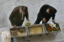 Sen. John Valentine, (left), R-Orem, and Rep. Jim Nielson, R-Bountiful, help themselves to a lunch banquet sponsored by a lobby organization in the rotunda of the State Capitol in late February. Nielson paid for his lunch. Tribune file photo