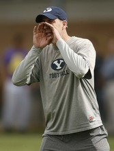 Trent Nelson  |  The Salt Lake Tribune BYU offensive coordinator Brandon Doman instructs his troops.