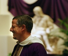 Steve Griffin  |  The Salt Lake Tribune The Rev. Carl Schlichte, pastor of St. Catherine of Siena Newman Center, walks in front of a replica of Pieta on display at the center.
