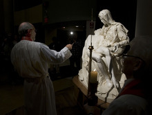 Steve Griffin  |  The Salt Lake Tribune Father Lincoln Ure, director of pastorial care at St. Mark's Hospital, blesses a replica of Michelangelo's Pieta. It was unveiled Nov. 9, 2010. The sculpture was temporarily donated to the hospital to be displayed in the main lobby for the rest of 2010.