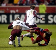 Steve Griffin     The Salt Lake Tribune   Real Salt Lake's Fabian Espindola grabs the jersey of  Colorado's Marvell Wynne as he falls to the ground during first half action in the Real Salt Lake versus Colorado Rapids at Rio Tinto Stadium in Sandy, Utah Wednesday, April 13, 2011.