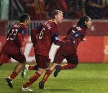 Steve Griffin     The Salt Lake Tribune   Real Salt Lake's Fabian Espindola, right, is chased by his teammates after scoring the winning goal in extra time in the Real Salt Lake versus Colorado Rapids at Rio Tinto Stadium in Sandyon Wednesday, April 13, 2011.