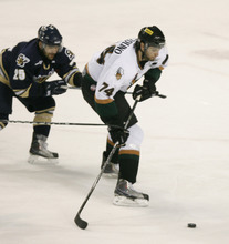 Rick Egan   |  The Salt Lake Tribune  Nick Tuzzolino goes for the puck for the Grizzlies, as Matt Cowie, (25) defends for the Salmon Kings, in hockey action, Utah Grizzlies vs. Victoria Salmon Kings, at the Maverick Center, Saturday, April 16, 2011