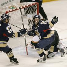 Rick Egan   |  The Salt Lake Tribune  Ryan Turek (55) and Adam Taylor (21) celebrate a Salmon King goal, in hockey action, Utah Grizzlies vs. Victoria Salmon Kings, at the Maverick Center, Saturday, April 16, 2011
