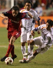 Leah Hogsten  |  The Salt Lake Tribune Real Salt Lake's Fabian Espindola topples Saprissa's Jose Mena who trips on his own. Real Salt Lake  played the first  its two-game series against Saprissa of Costa Rica in the CONCACAF Champions League at Rio Tinto Stadium  Tuesday March 15, 2011.
