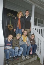 Paul Fraughton  |  The Salt Lake Tribune The Scheffner family on the front porch of their Sandy home. Parents Gary and Jennifer, top step, are parents to four boys, from left, Zach, Jake, Ben and Sam.