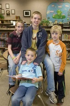 Paul Fraughton  |  The Salt Lake Tribune The Scheffner kids at Sunrise Elementary School's  library on  Tuesday,  April 12, 2011. Clockwise from front: Zach, Sam, Ben and Jake.