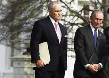 New York City Mayor Michael Bloomberg, right, and New York City Police Commissioner Raymond Kelly are pictured on the North Lawn after meeting with President Obama about immigration reform at the White House in Washington, Tuesday, April 19, 2011. (AP Photo/Charles Dharapak)