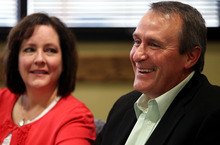 AP Photo/Steve C. Wilson Utah Attorney General Mark Shurtleff, right, laughs with his wife, M'Liss, by his side in this file photo. The attorney general is suing the BCS saying he sees it as not just counter to what college sports should be about, not just unfair to certain schools and student-athletes, not just competitively wrong, but flat-out illegal.