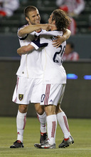 Real Salt Lake's defender Chris Wingert, left, celebrates with teammate midfielder Ned Grabovoy after Wingert scores against Chivas USA in the first half of an MLS soccer match, Saturday, May 22, 2010, in Carson, Calif. (AP Photo/Alex Gallardo)