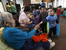 Francisco Kjolseth  |  The Salt Lake Tribune Ruth Oka, an Alzheimer's patient at the Riverside Adult Day Center in Salt Lake City, reaches out to say goodbye to Eric De La Paz, 4, during a Thursday visit between seniors and preschoolers.