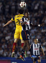 Mexico's Monterrey Walter Ayovi, right, fights for the ball with U.S. Real Salt Lake's Ned Grabavoy during the Concacaf Champions League first leg final soccer match in Monterrey, Mexico, Wednesday, April 20, 2011. (AP Photo/Miguel Tovar)