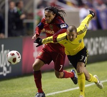 Steve Griffin  |  The Salt Lake Tribune   Real Salt Lake's Fabian Espindola, left, battles Josh Gardner, of Columbus, during first half action in the CONCACAF Champions League quarterfinal game at Rio Tinto Stadium in Sandy, Utah Tuesday, March 1, 2011.